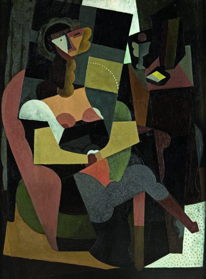 Mujer sentada en una butaca (1917). No es la pintura de Picasso del mismo nombre, sino la pieza casi centenaria del gran Rivera.